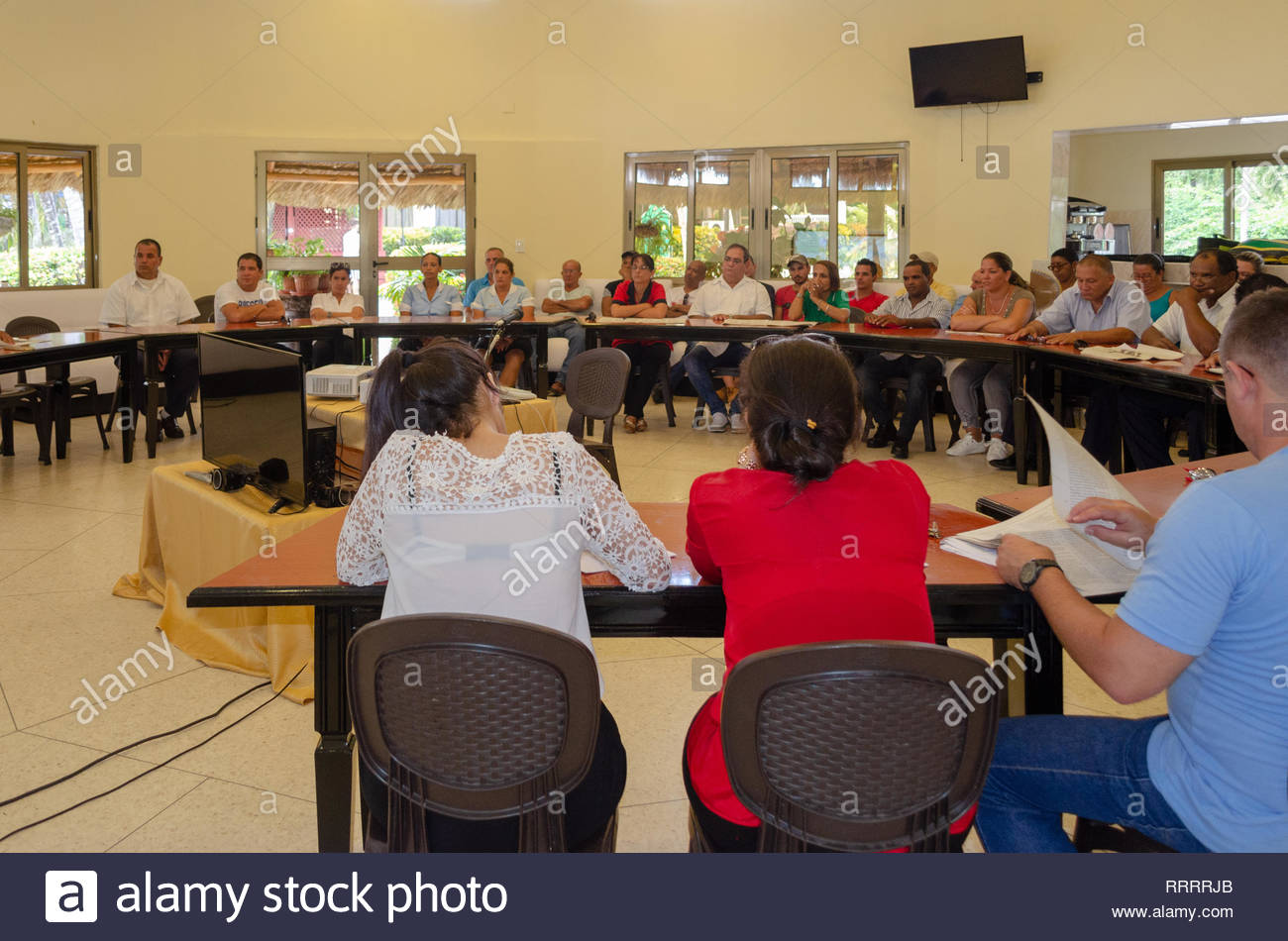 Santa Clara, Cuba-September 12,2018: Workers of Villa La Granjita Hotel discuss the new proposed constitution. The meeting happens in the conference r - Stock Image