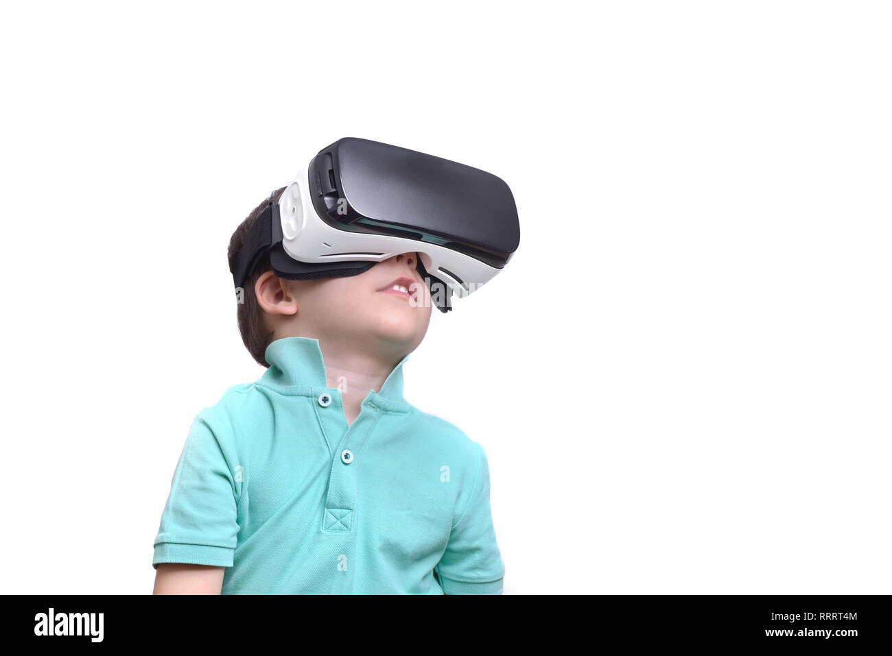 482e7ea6357 Amazed teen boy wearing virtual reality goggles watching movies or playing  video games
