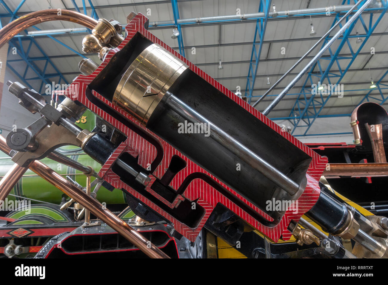Cutaway of a piston on the replica of Stephenson's Rocket, as it appeared in 1829, on display in the National Railway Museum, York, UK. - Stock Image