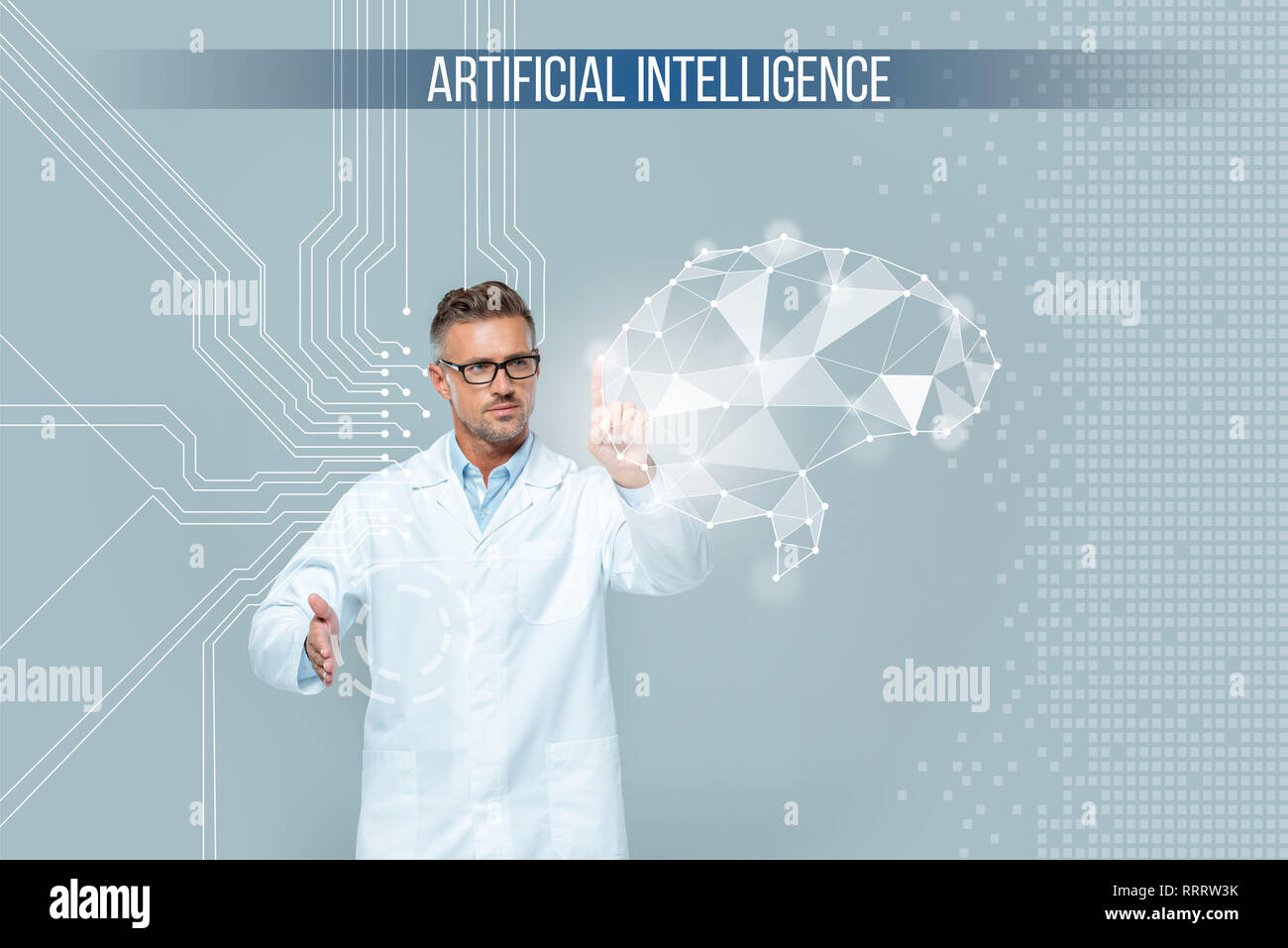 handsome scientist in glasses touching brain interface isolated on