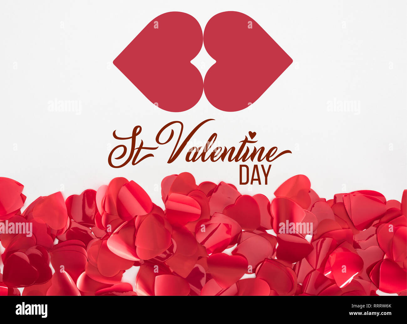 close-up view of beautiful red heart shaped petals on grey background with 'st valentine day' lettering - Stock Image