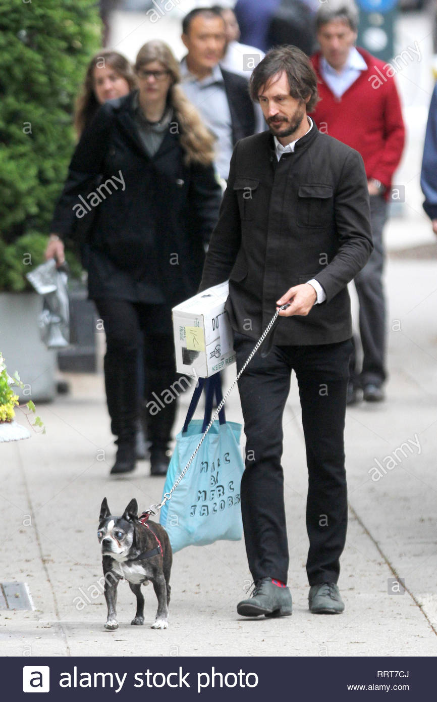 4d7cf03b2 New York, NY - Famke Janssen and her boyfriend Cole Frates take her dog  Licorice for a stroll in New York. The