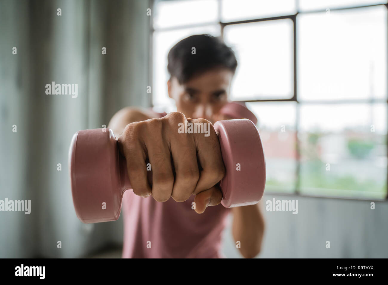 dumbbell punch towards the camera - Stock Image