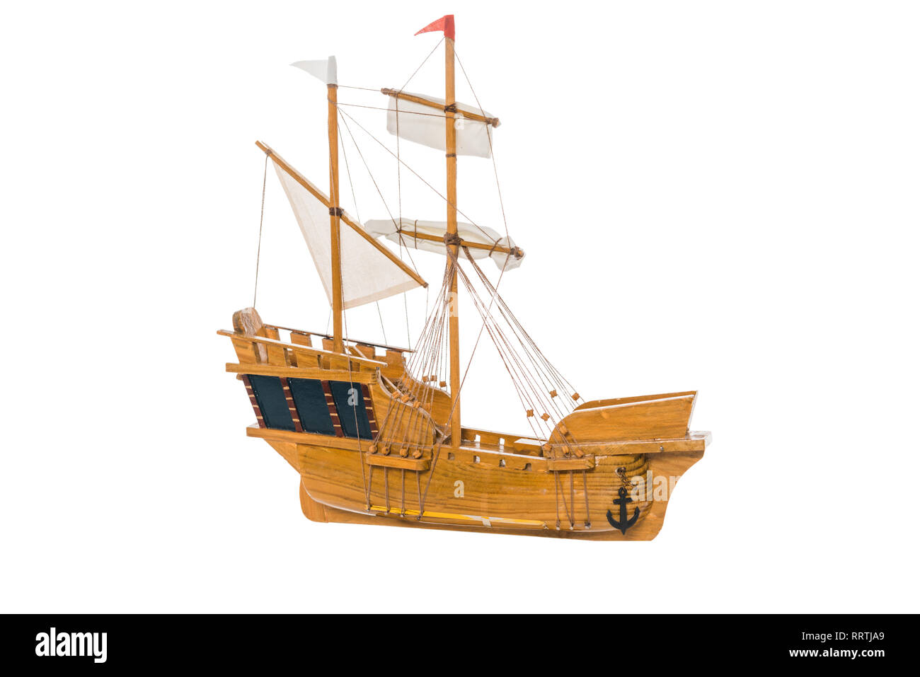 wooden ship model floating in air isolated on white - Stock Image