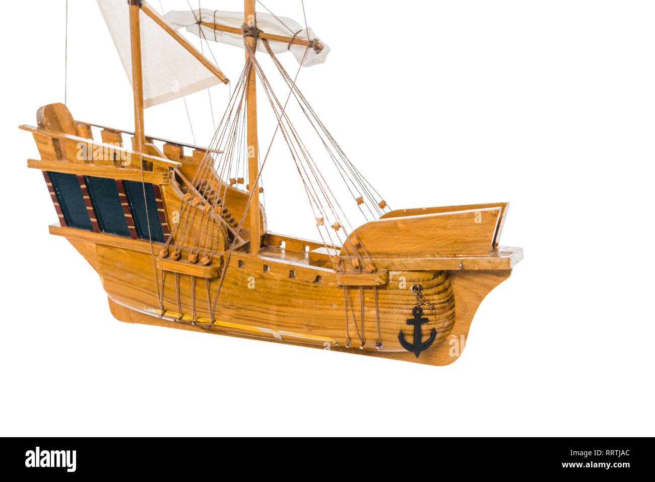 vintage wooden ship model floating in air isolated on white with copy space - Stock Image
