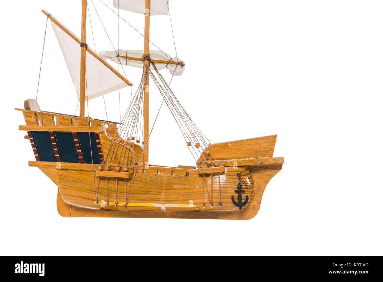 vintage wooden ship model floating in air isolated on white - Stock Image
