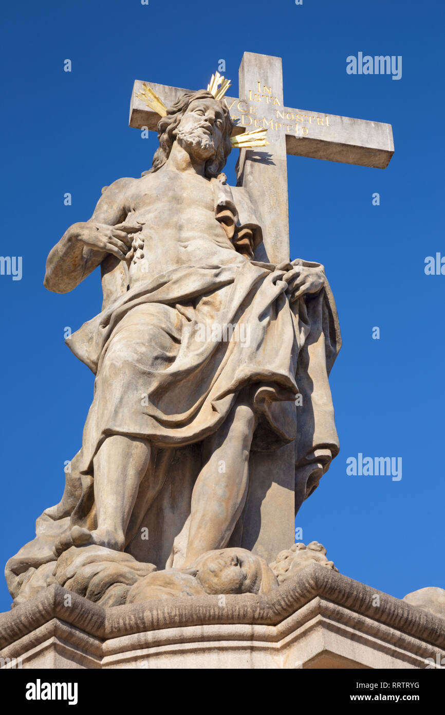 Prague - The detail of baroque staue of Jesus from sculptural group with st. Cosmos and st. Damian from Charles bridge by Jan Oldřich Mayer (1666 – 17 - Stock Image