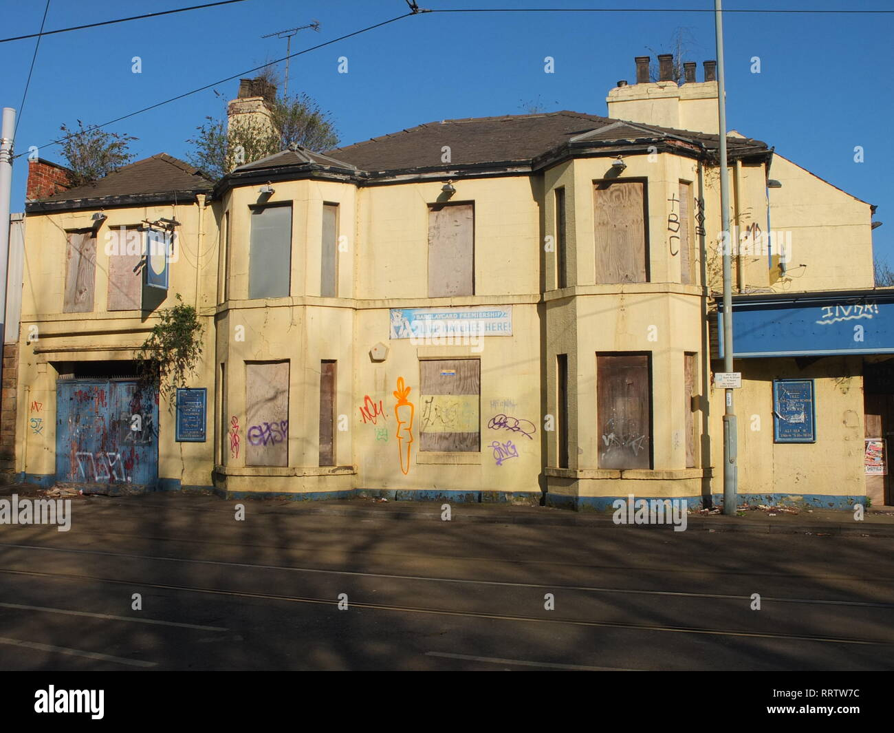 Plants growing out of a closed down, semi derelict former pub (The Burgoyne Arms) in Sheffield, UK. Shut pub Stock Photo