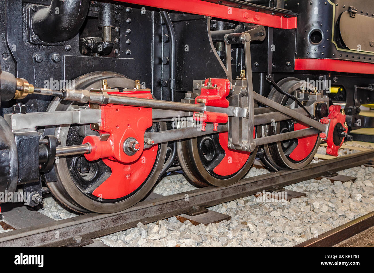 The wheels of the old locomotive. Stock Photo
