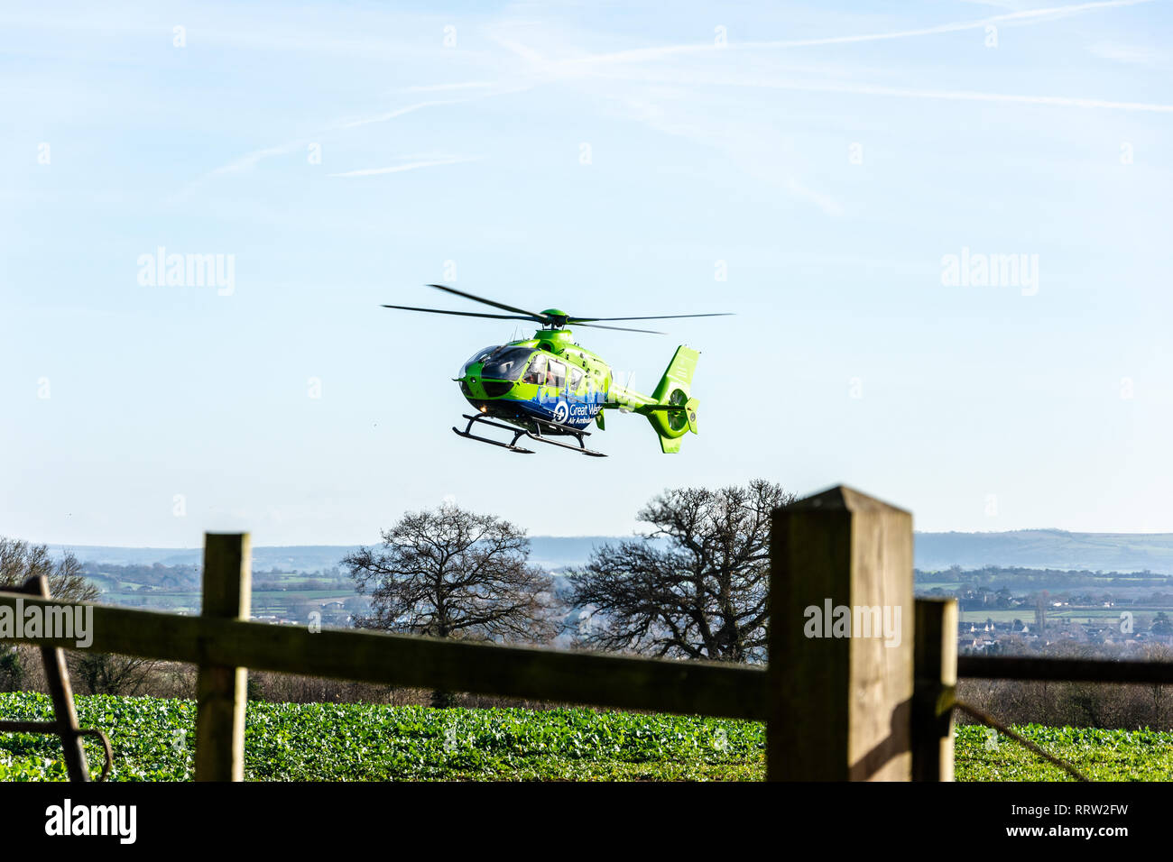 Bradford Leigh Wiltshire UK January 9th 2019 The Great Western air ambulance helicopter taking off from a field Stock Photo