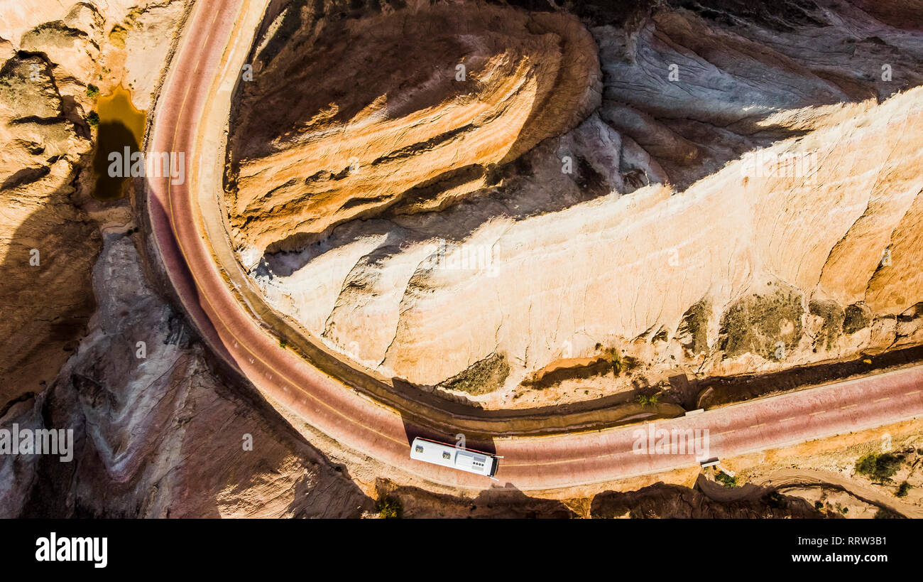 Top View of Rainbow Mountains Geological Park. Stripy Zhangye Danxia Landform Geological Park in Gansu Province, China. Drone Picture of Tourist Buses - Stock Image