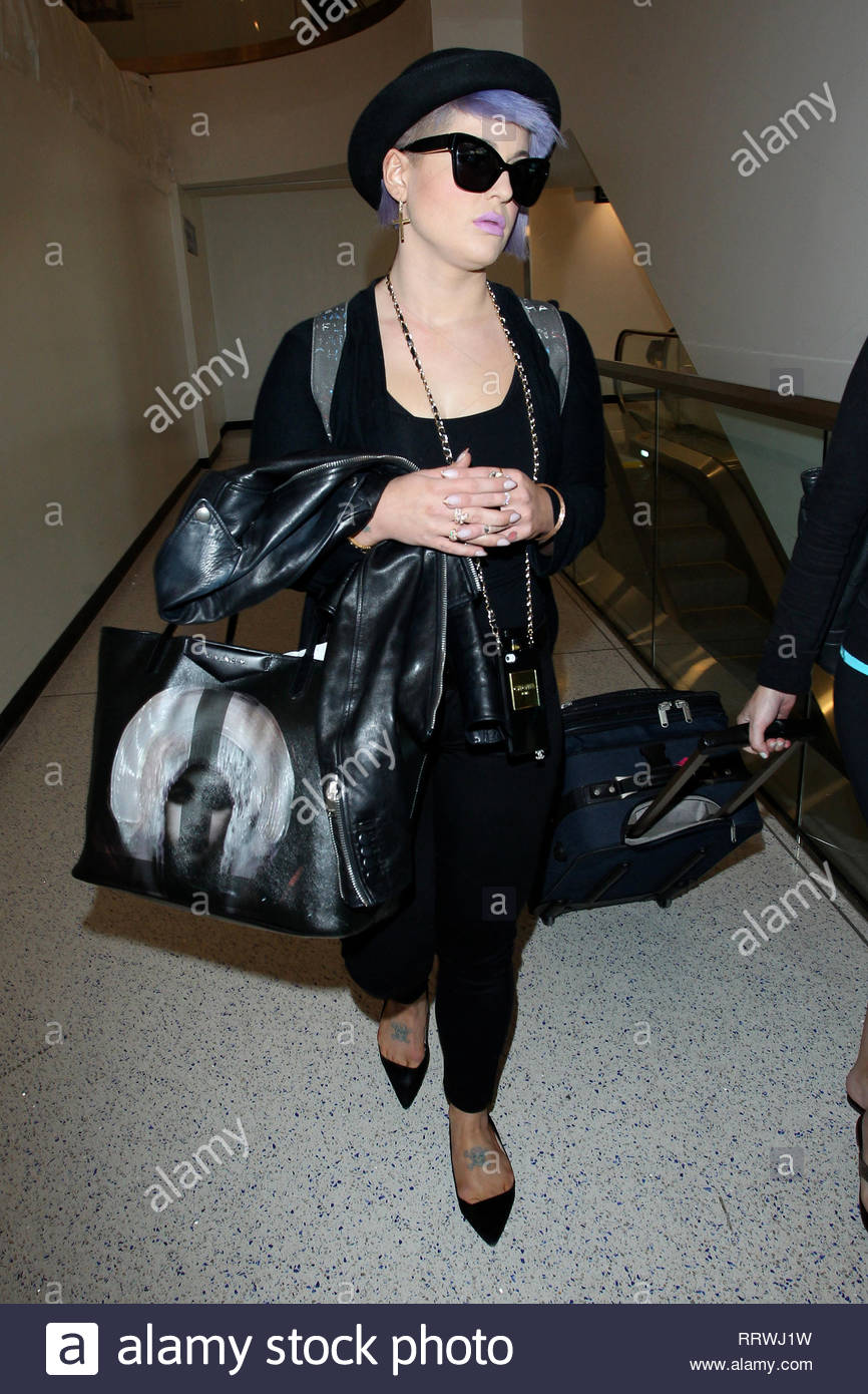 5f45d51af9bf **USA ONLY** Los Angeles, CA - Kelly Osbourne hides behind her dark  sunglasses as she makes her way through LAX airport. The reality TV star,  ...