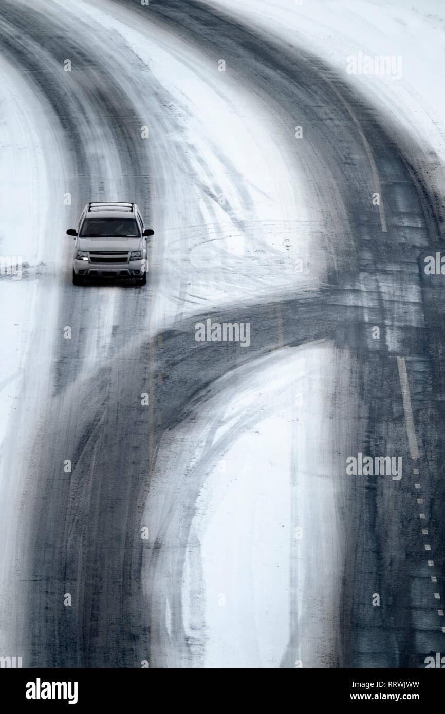 Driving on winter roads traveling stormy weather dangerous