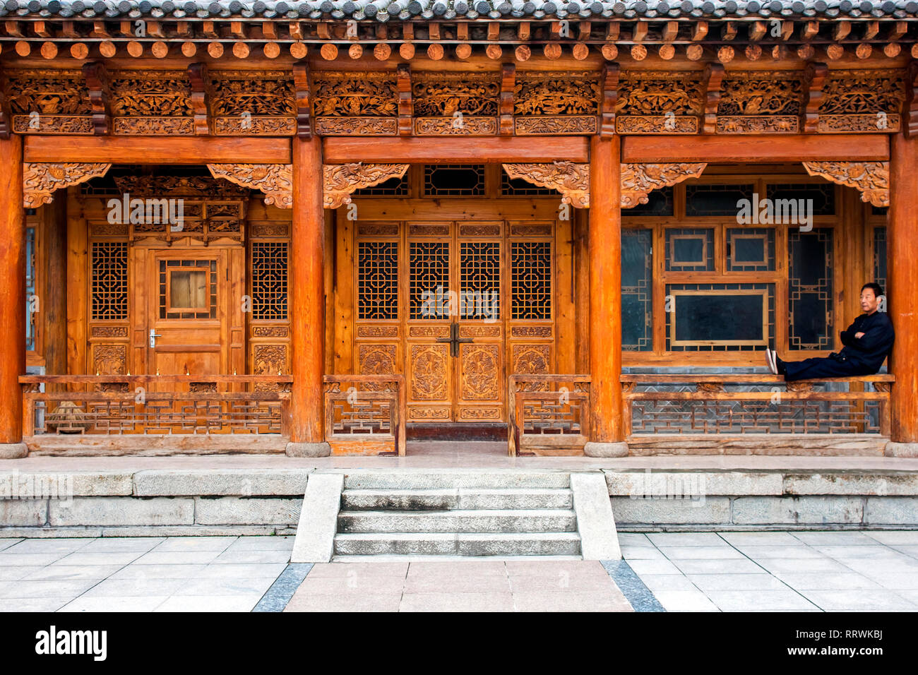 CHINA, XINING - SEPTEMBER 15, 2018. Traditional Wooden Chinese Architecture Of One Storie House. Courtyard Of A Renovated Oriental Building. - Stock Image