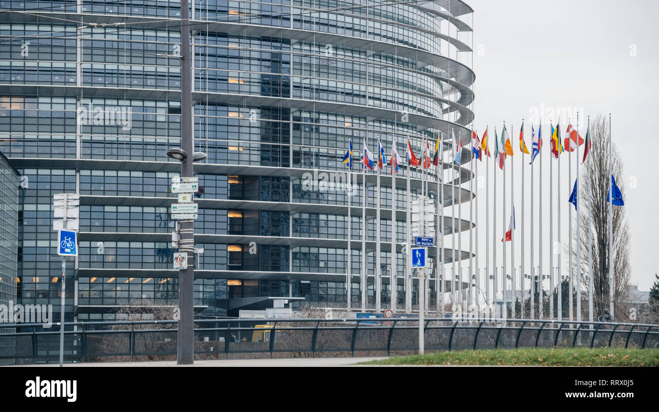 STRASBOURG, FRANCE - DEC 11, 2018: Horizontal view over European Union and French Flags flies at half-mast in front of the European Parliament following an attack in center of Strasbourg during annual Christmas Market - Stock Image