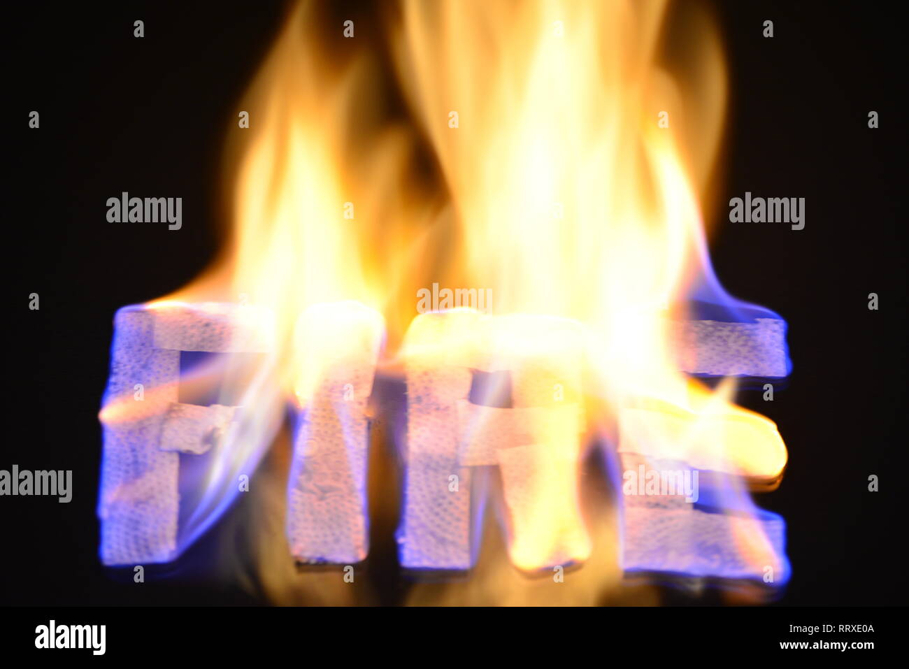 Fire of word in background - flame fire Stock Photo