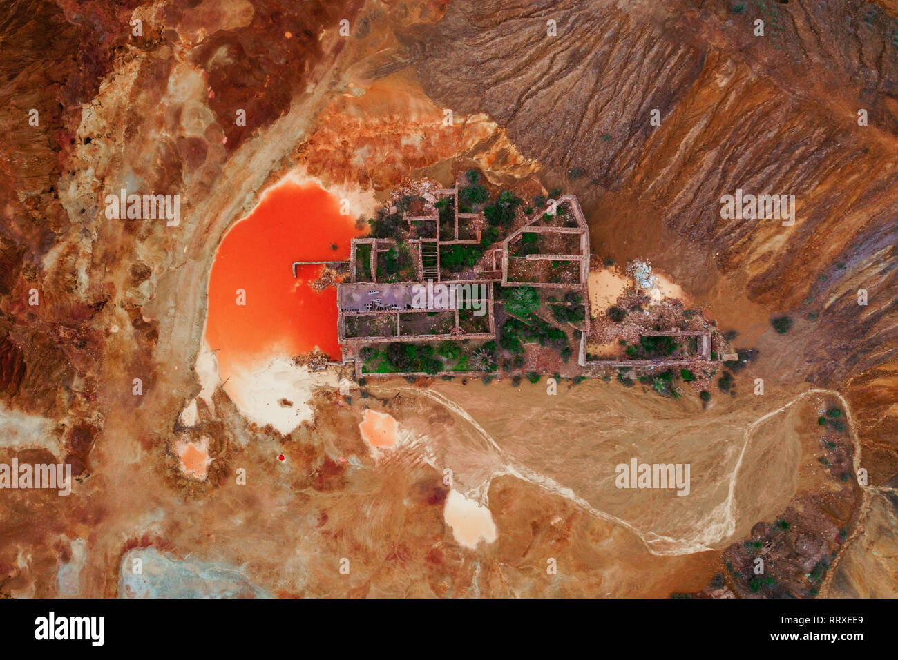 From above aerial view to historic ruins in orange ground - Stock Image