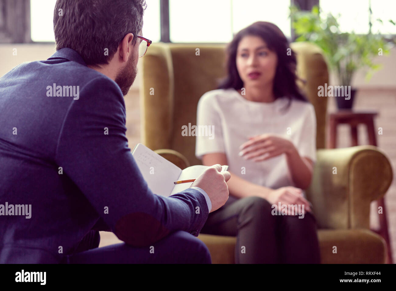Selective focus of a smart experienced psychologist - Stock Image