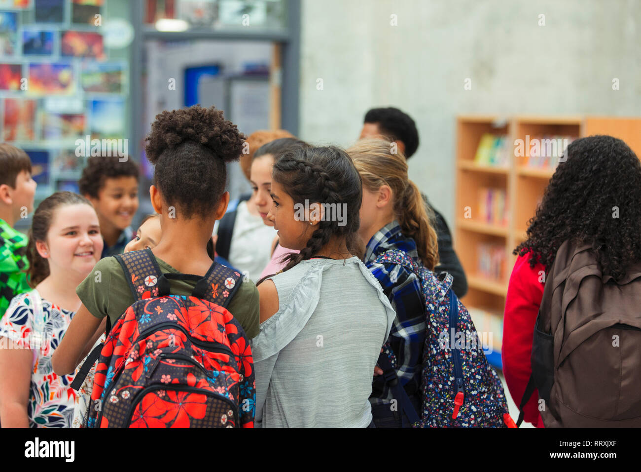 Junior high girl students talking in library Stock Photo