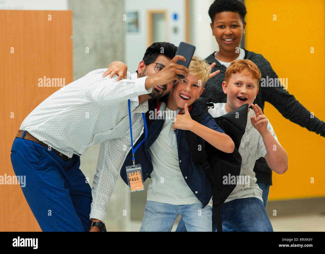 Junior high boy students and male teacher taking selfie with smart phone Stock Photo