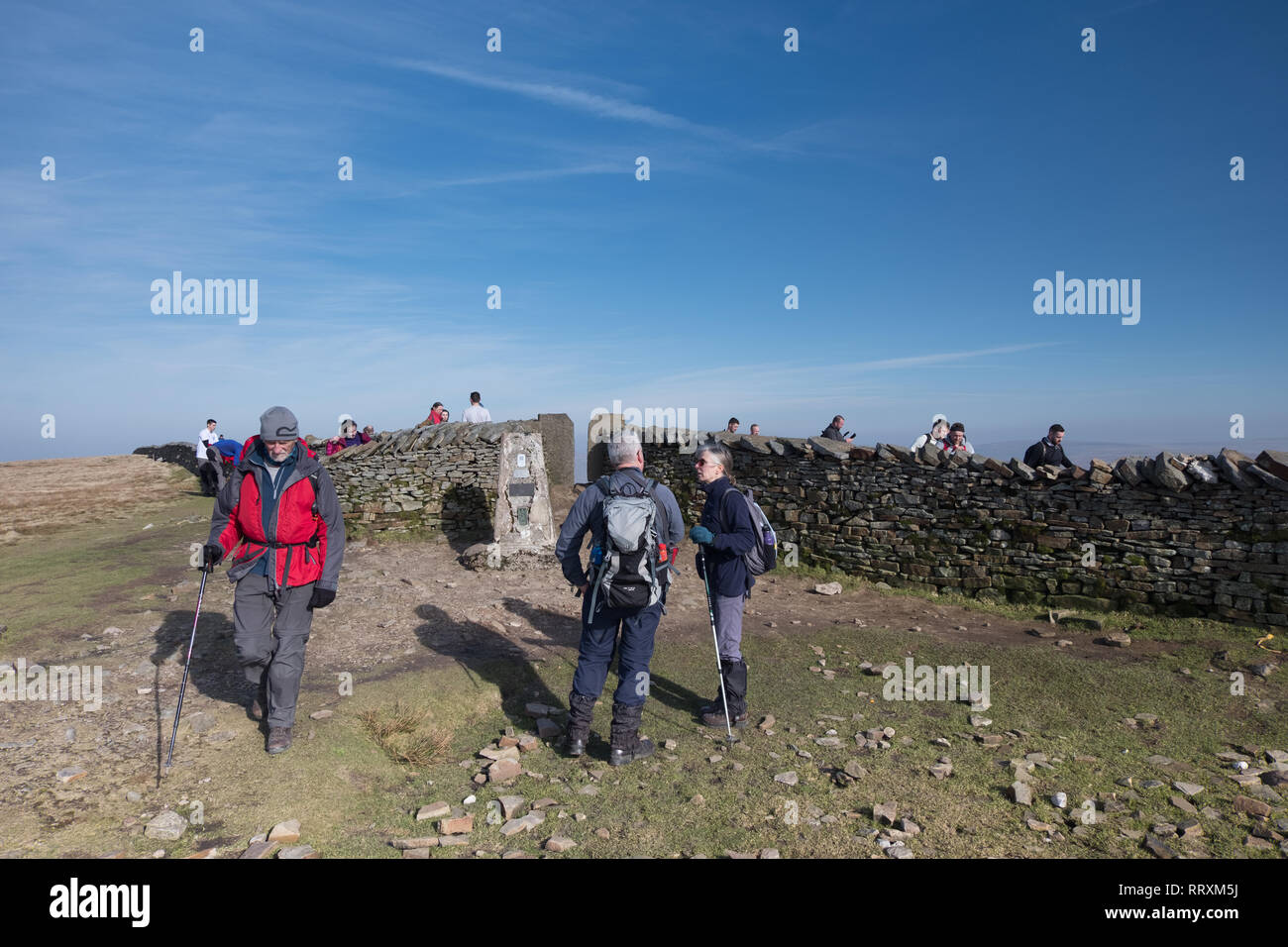 Hill walkers on the summit of Whernside in the Yorkshire Dales - Stock Image