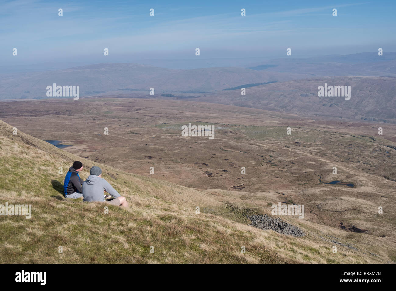 Hill walkers resting at the summit of Whernside in the Yorkshire Dales - Stock Image