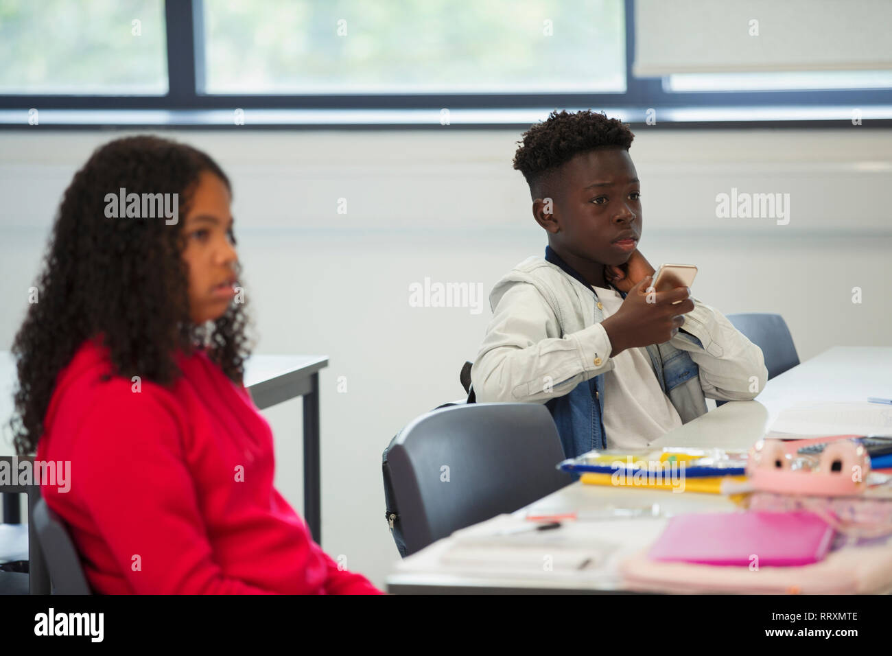 Junior high school students listening in classroom Stock Photo