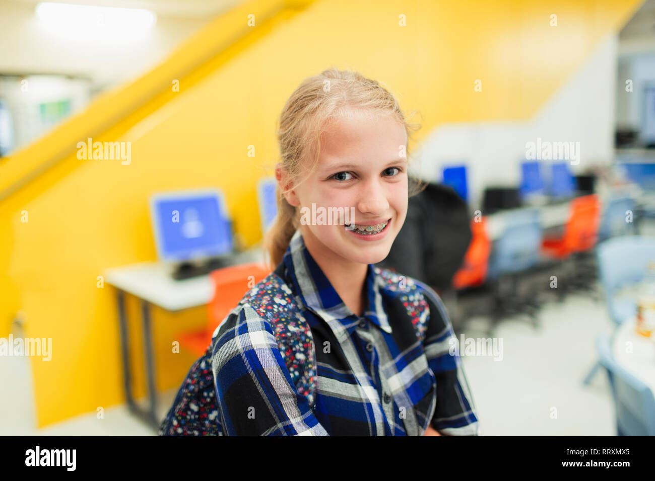 Portrait confident junior high girl student with braces Stock Photo
