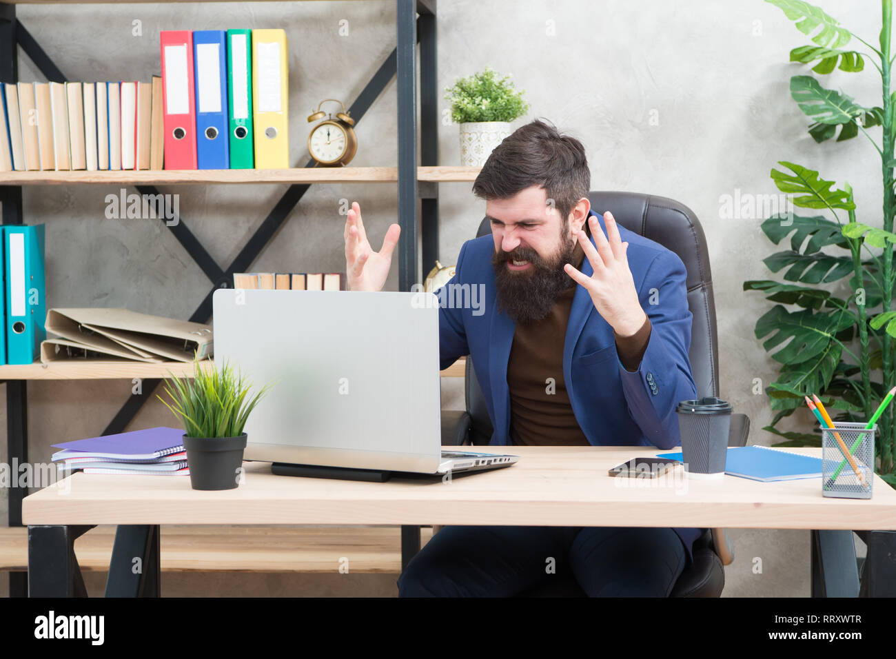 Got into mess. Man bearded boss manager sit office with laptop. Manager solving business problems online. Business man failed. Risky business. Broker and financial indicators. Falling stock prices. - Stock Image