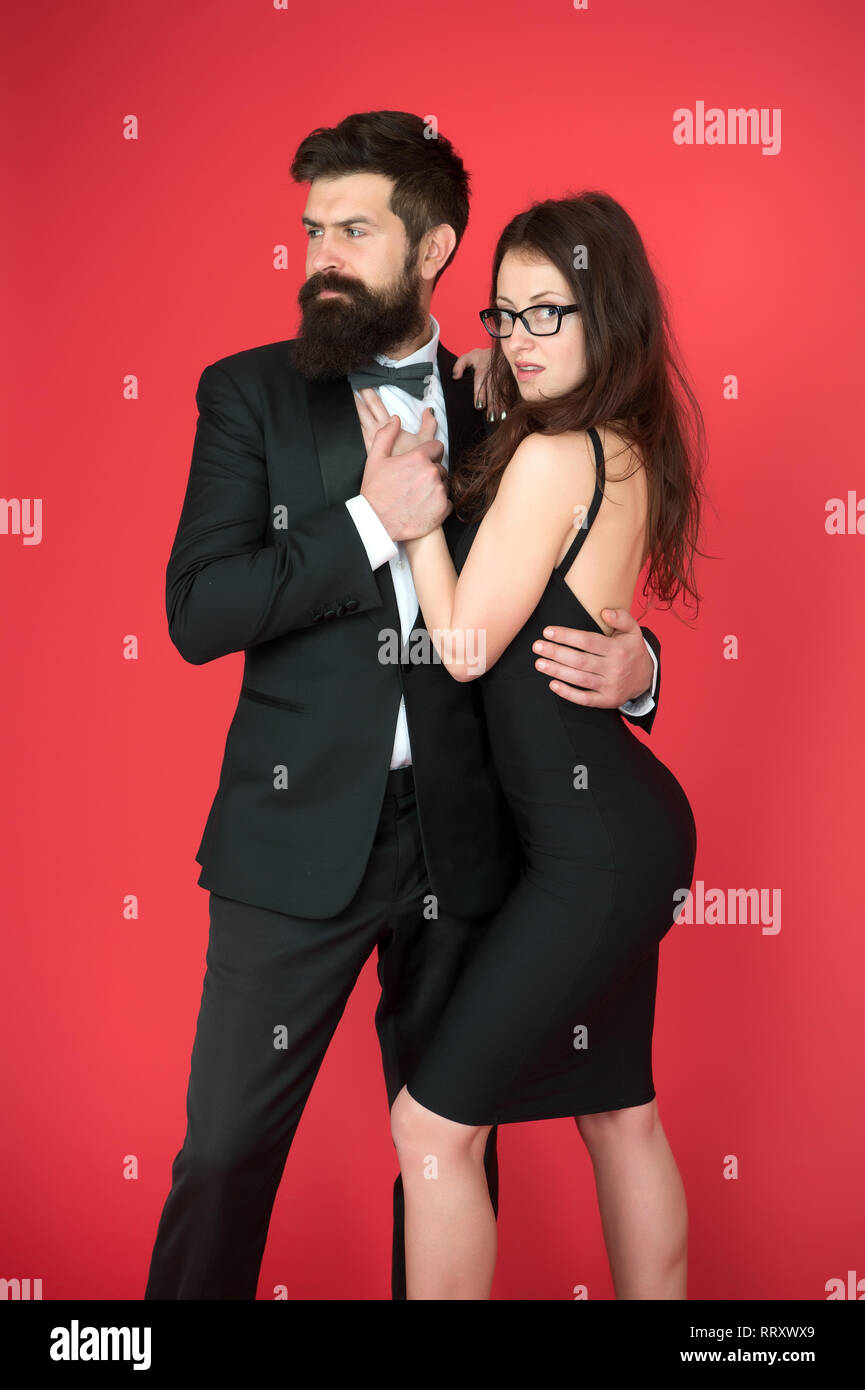 Bearded man wear suit girl elegant dress. Formal dress code. Visiting event or ceremony. Couple ready for award ceremony. Corporate party. Award ceremony concept. Elegance is not about being noticed. - Stock Image
