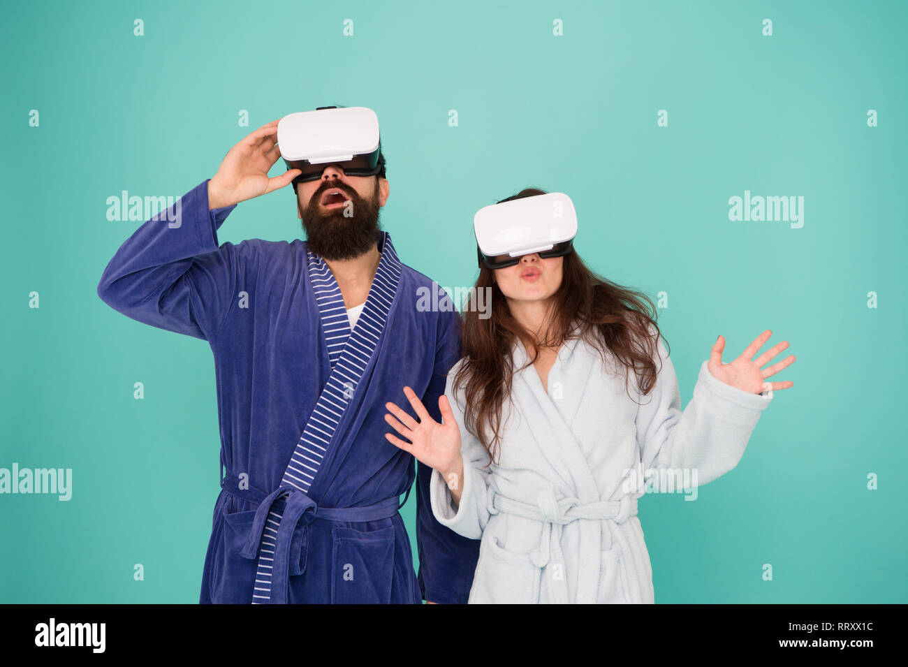 a274e2b87940 Virtual reality. Love. Good morning. surprised family in vr glasses. Couple  in