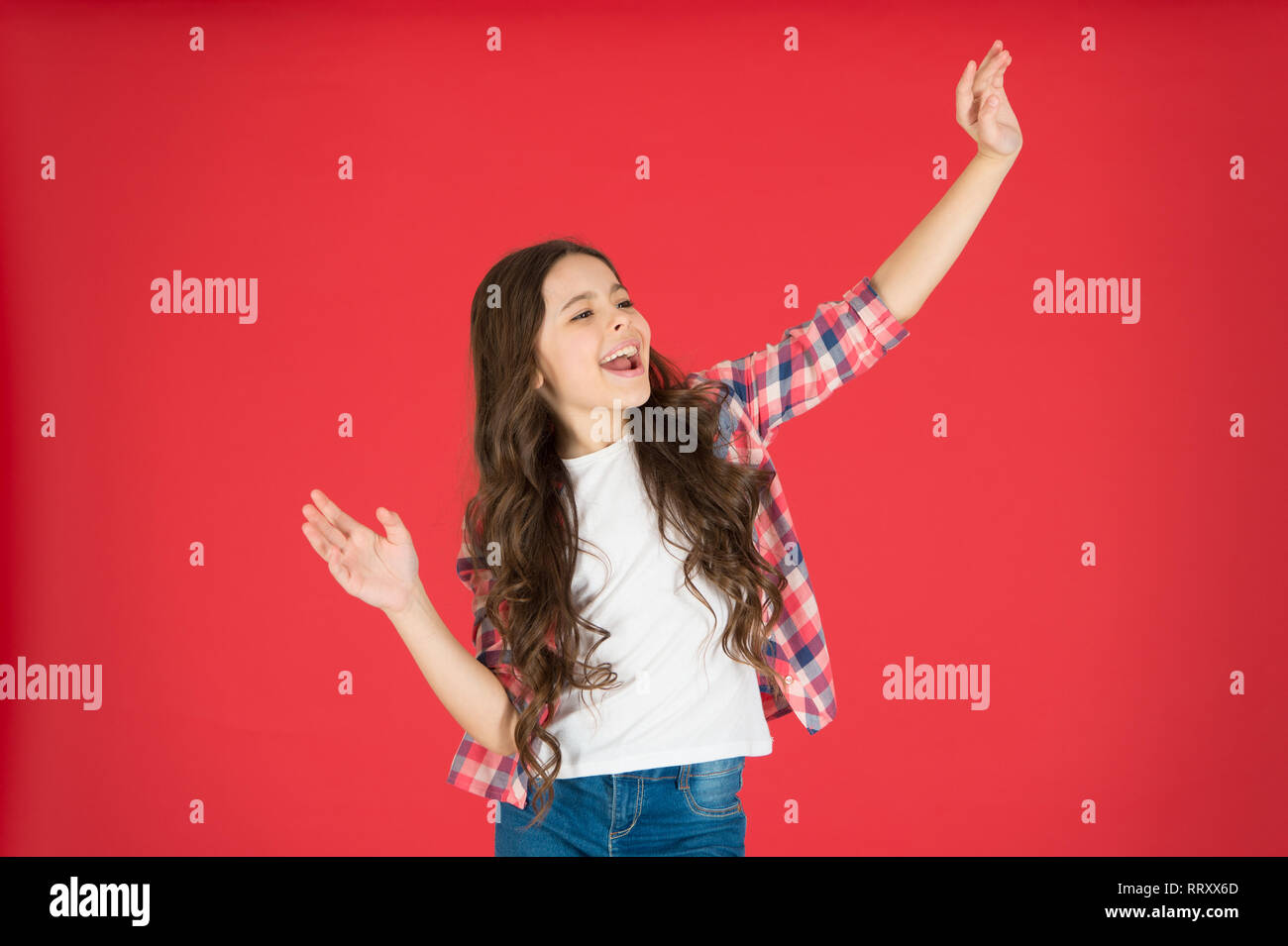 Happy little girl on red background little girl dancing little cutie smiling girl express positivity here i am