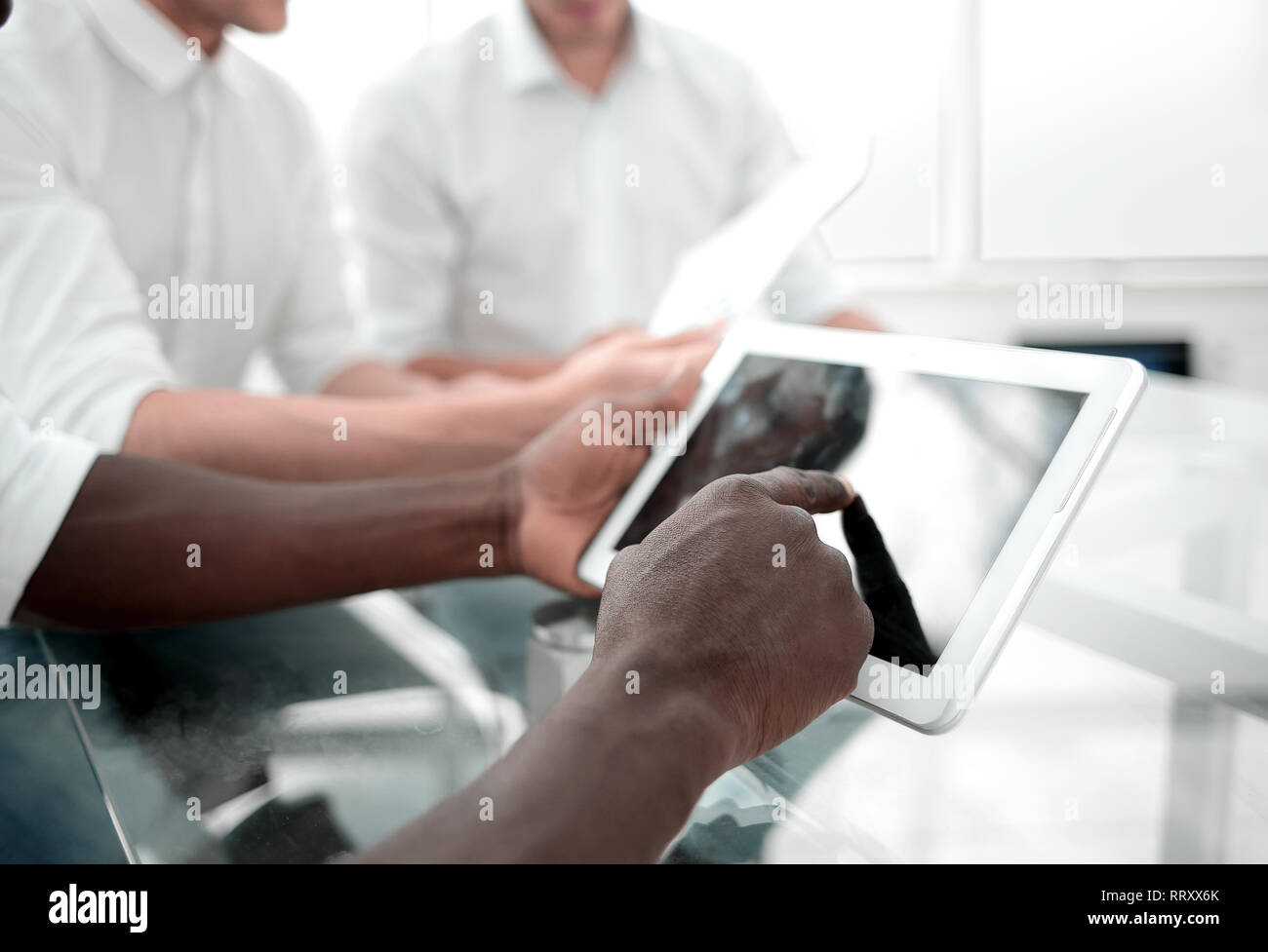 employee tapping the screen of the digital tablet. - Stock Image