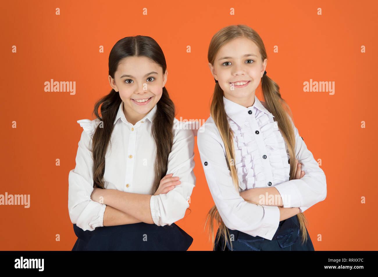 e706965f5ab9 Cute schoolgirls. Little girls wearing school uniform. Stylish girls in  pigtails dressed for school. Back to school fashion style.