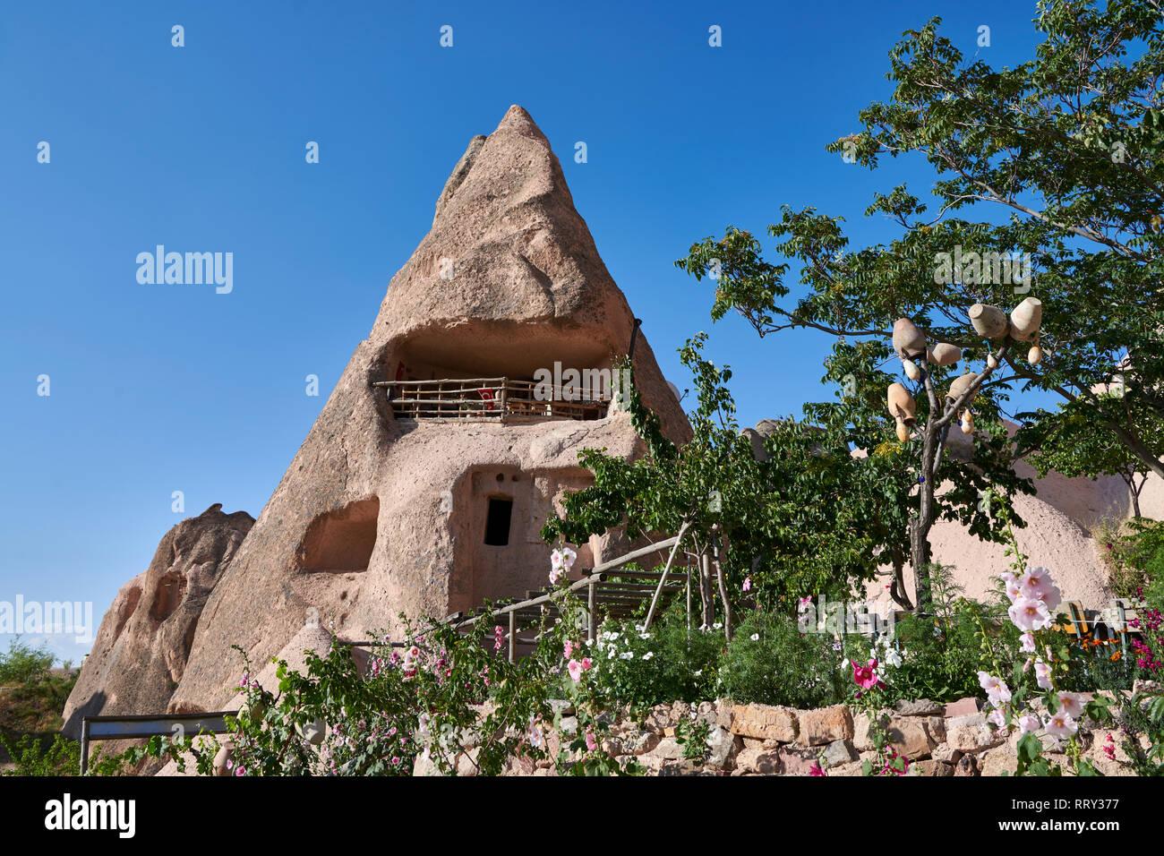 Cafeteria Balkonlu a typical fairy chimney cave house, Uchisar, near Goreme, Cappadocia, Nevsehir, Turkey - Stock Image
