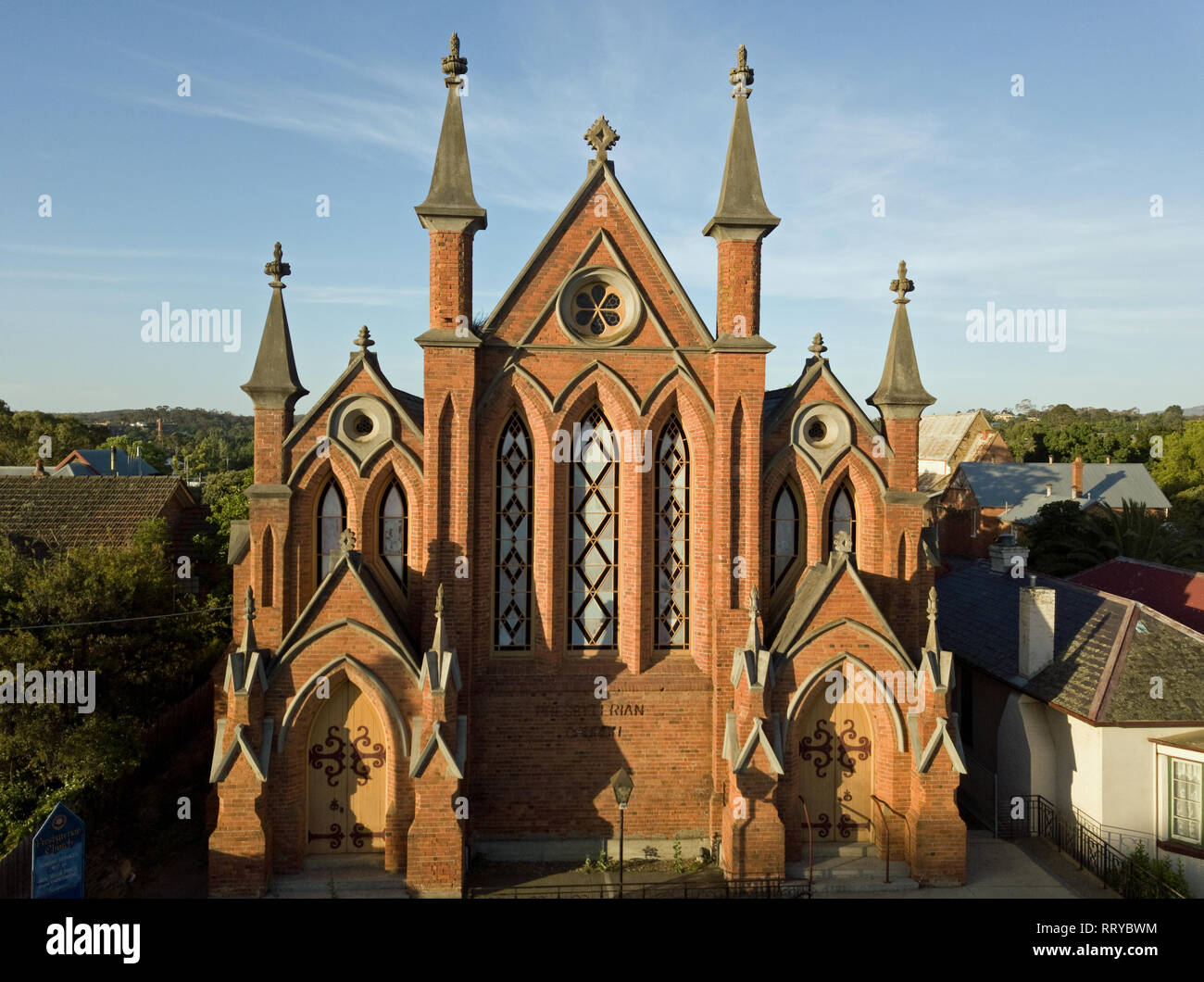 Small town church Australia. Exterior view church building, church spire, facade and windows. Captured with aerial photography in Victoria, Australia. - Stock Image
