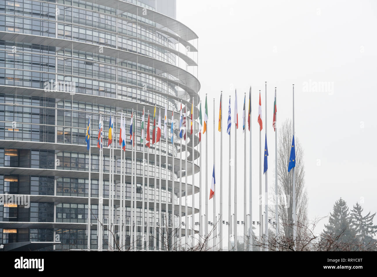 STRASBOURG, FRANCE - DEC 11, 2018: Side view of the European Union and French Flag flies at half-mast in front of the European Parliament following an attack in center of Strasbourg during annual Christmas Market - Stock Image