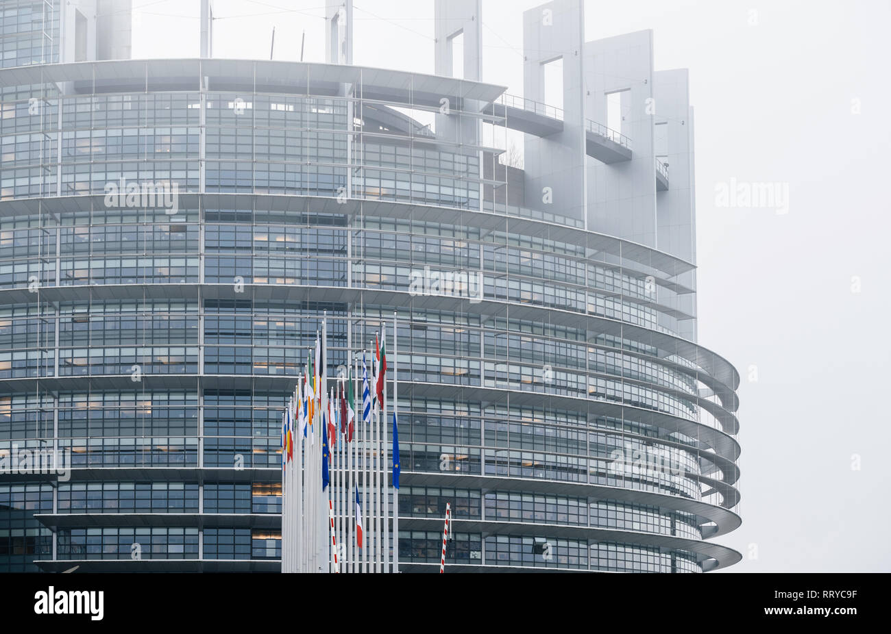 STRASBOURG, FRANCE - DEC 11, 2018: European Union and French Flags flies at half-mast in front of the European Parliament following an attack in center of Strasbourg during annual Christmas Market - Stock Image