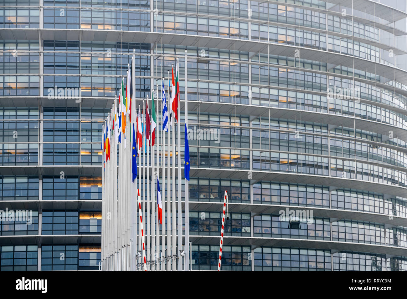STRASBOURG, FRANCE - DEC 11, 2018: Mist over European Union and French Flags flies at half-mast in front of the European Parliament following an attack in center of Strasbourg during annual Christmas Market - Stock Image