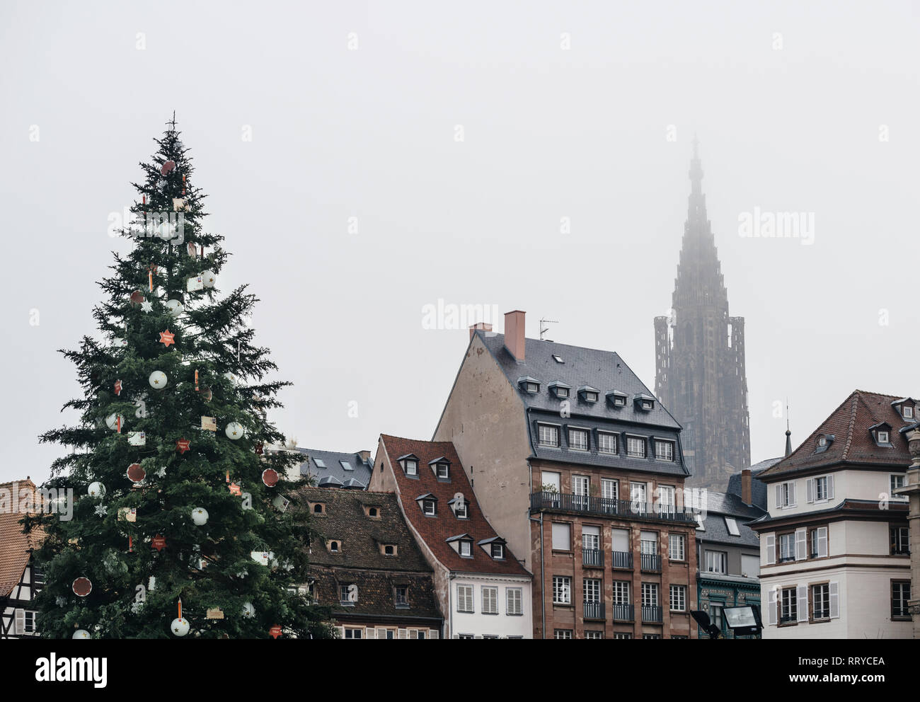 Strasbourg Christmas Market and Notre-Dame Cathedral in mist after terrorist attack held on December 11, 2018 - Stock Image