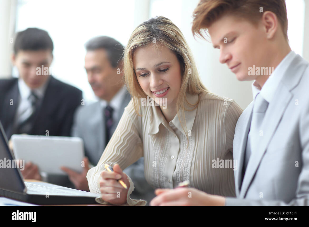 blurred image of a business team working on financial scheduling - Stock Image