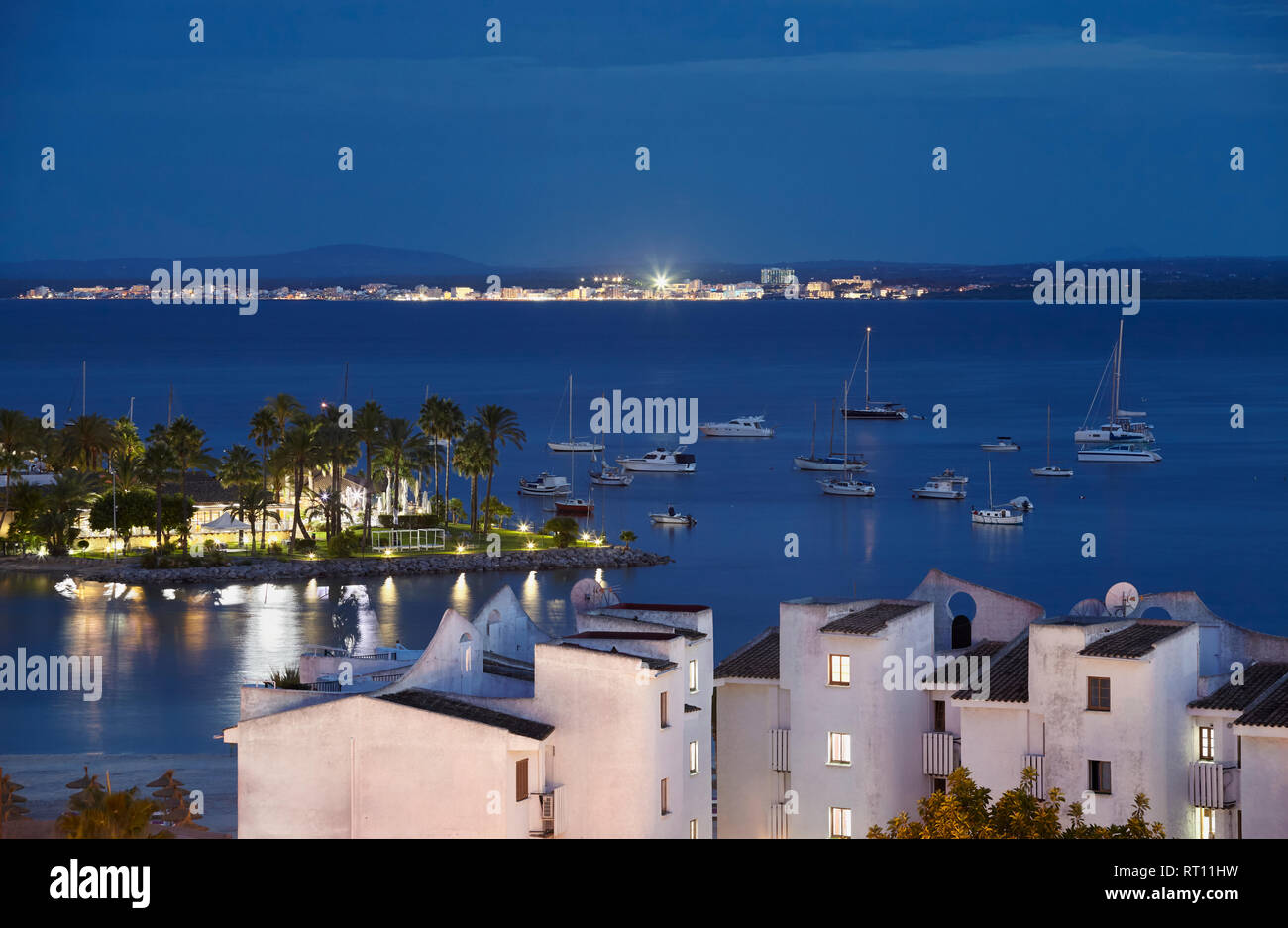 View of Port de Alcudia during the blue hour, Mallorca, Spain. - Stock Image
