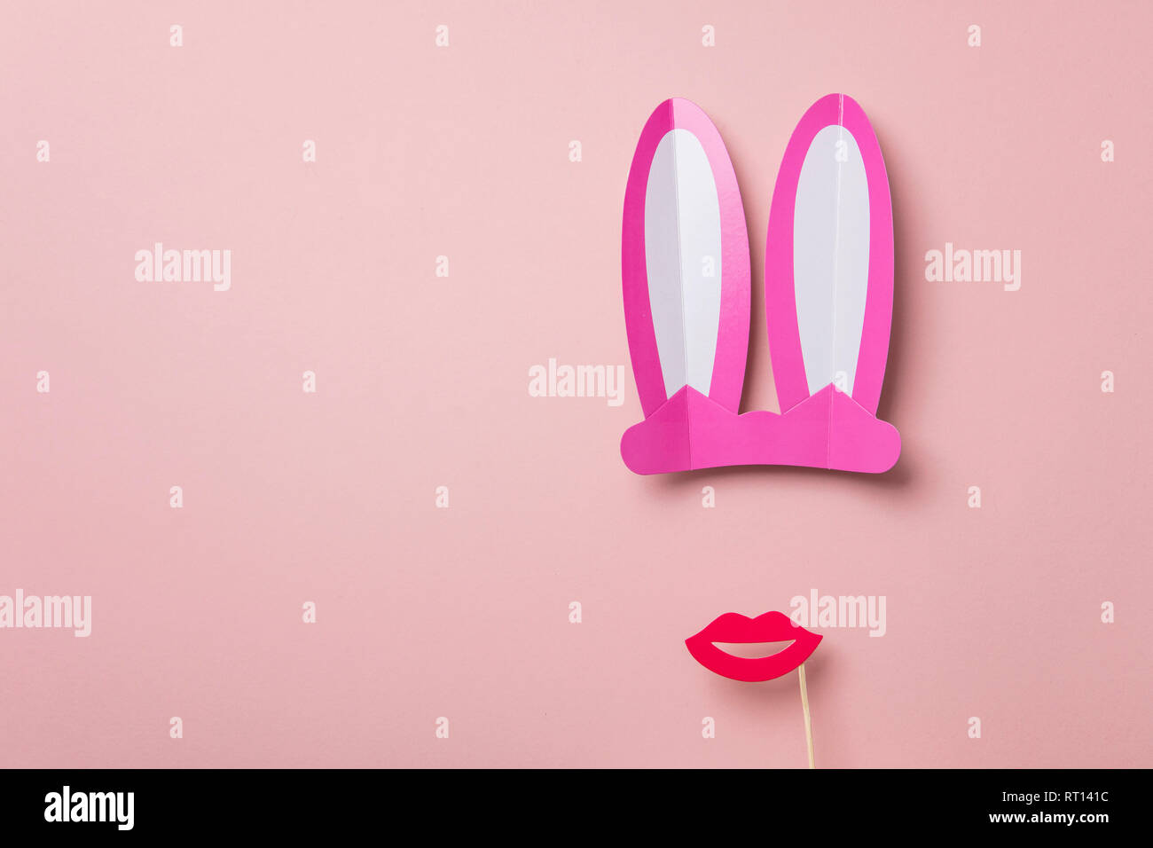 Pink Easter bunny ears and red lips. Minimal lay flat design - Stock Image