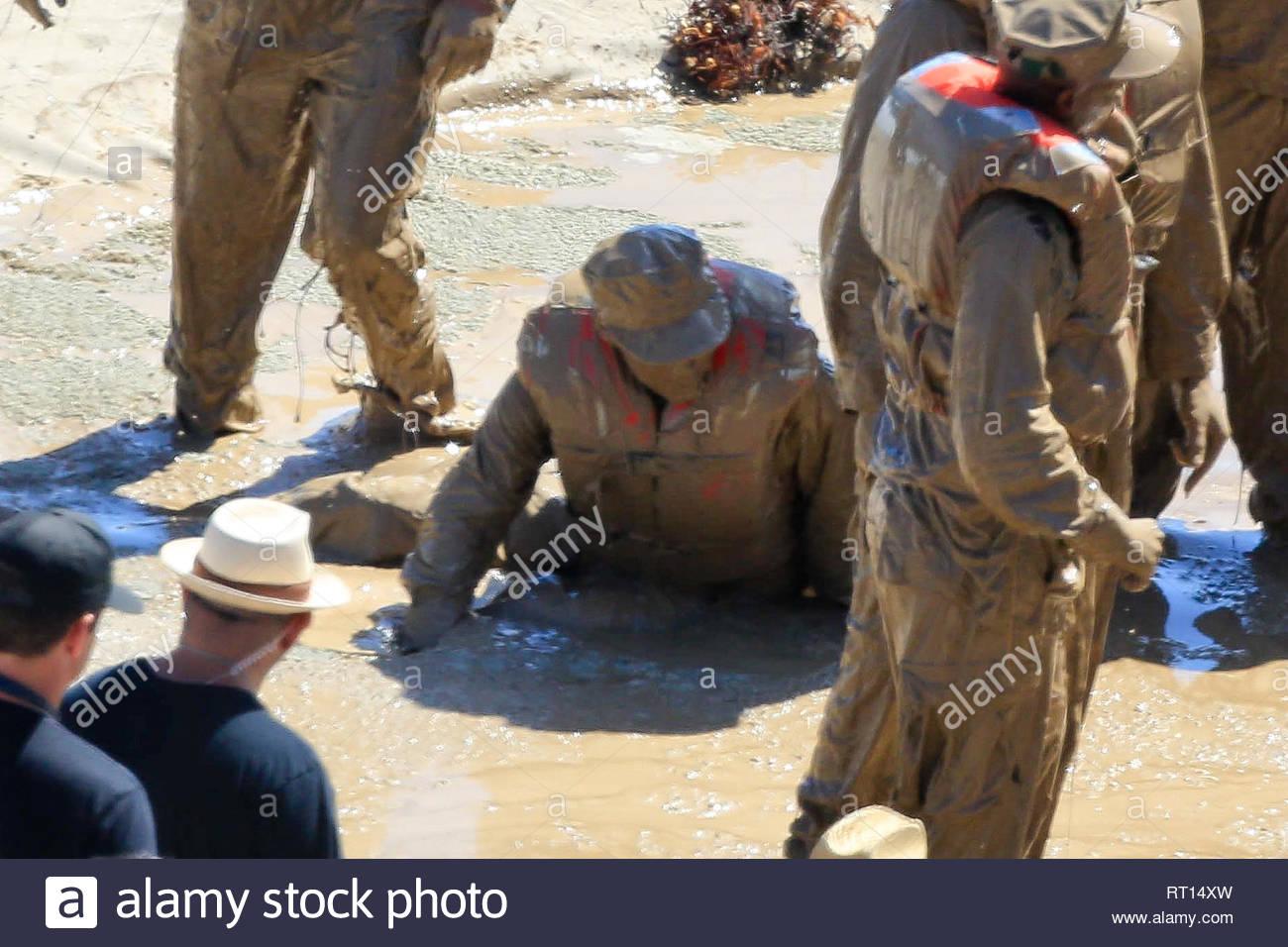 Malibu, CA - Bradley Cooper gets wet and dirty as he films