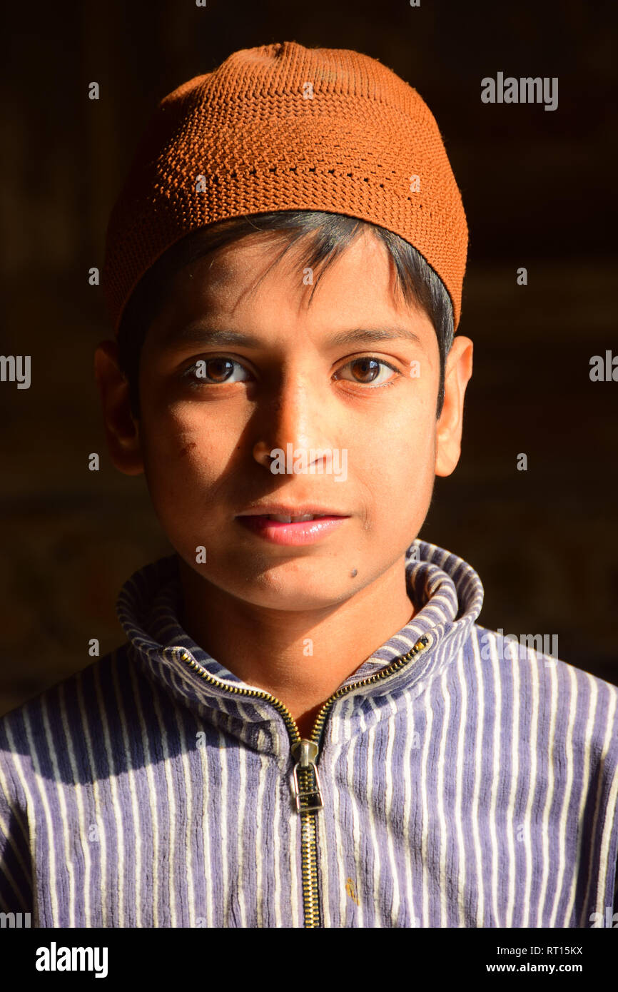 Portrait, Handsome young Indian Boy with hat, ethnic shirt, Baby Taj, Mughal mausoleum, Agra, India - Stock Image