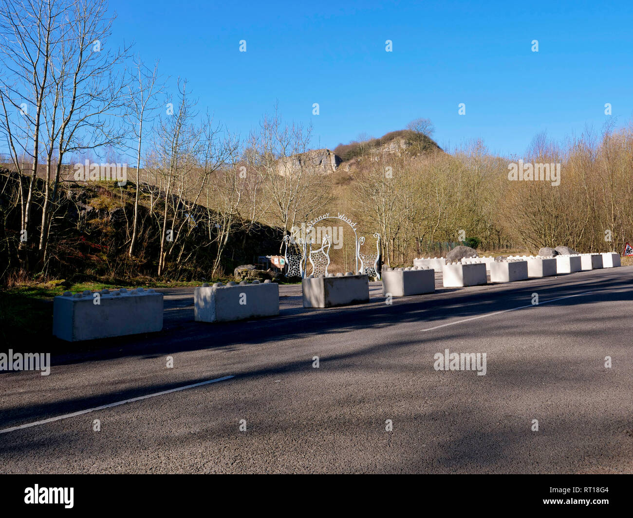 Wirksworth, Derbyshire Dales, UK. 27th Feb 2019. Concrete blocks placed on the carpark to protect Wirksworth beauty spot owned by Wirksworth Town Council (Labour) after Derbyshire Dales District Council (Conservative) voted on relocating a GRT Travellers camp on disputed land adjacent to Stoney Wood, Wirksworth, Derbyshire Dales. Wirksworth Town Council are seeking legal advise to try & protect the trees, rare wild orchids & other wildlife in and around this Sight of Special scientific Interest. Credit: Doug Blane/Alamy Live News - Stock Image