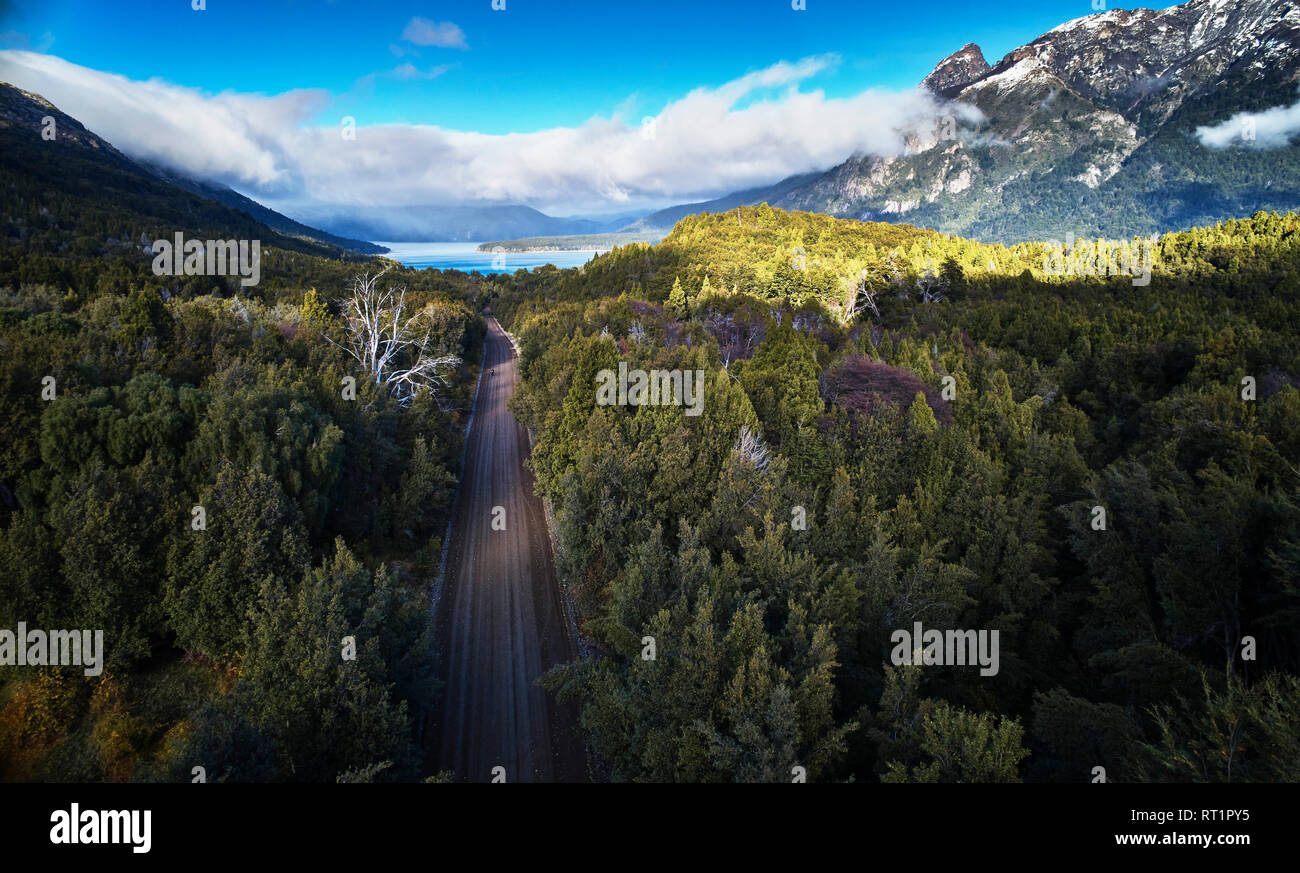 Argentina, Patagonia, Lago Futalaufquen, drone picture of gravel road through forest - Stock Image