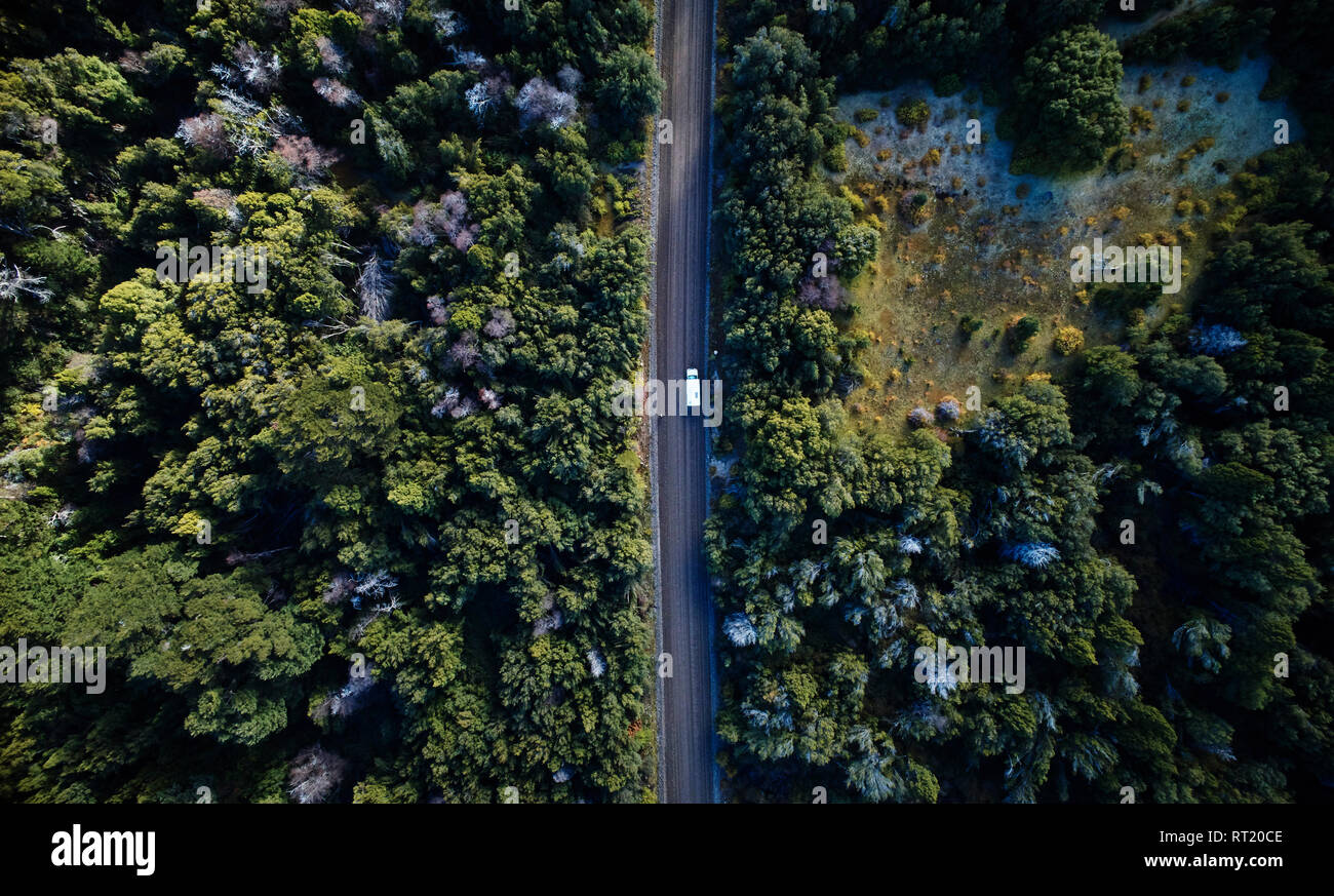 Argentina, Patagonia, Lago Futalaufquen, drone picture of camper on gravel road in forest - Stock Image