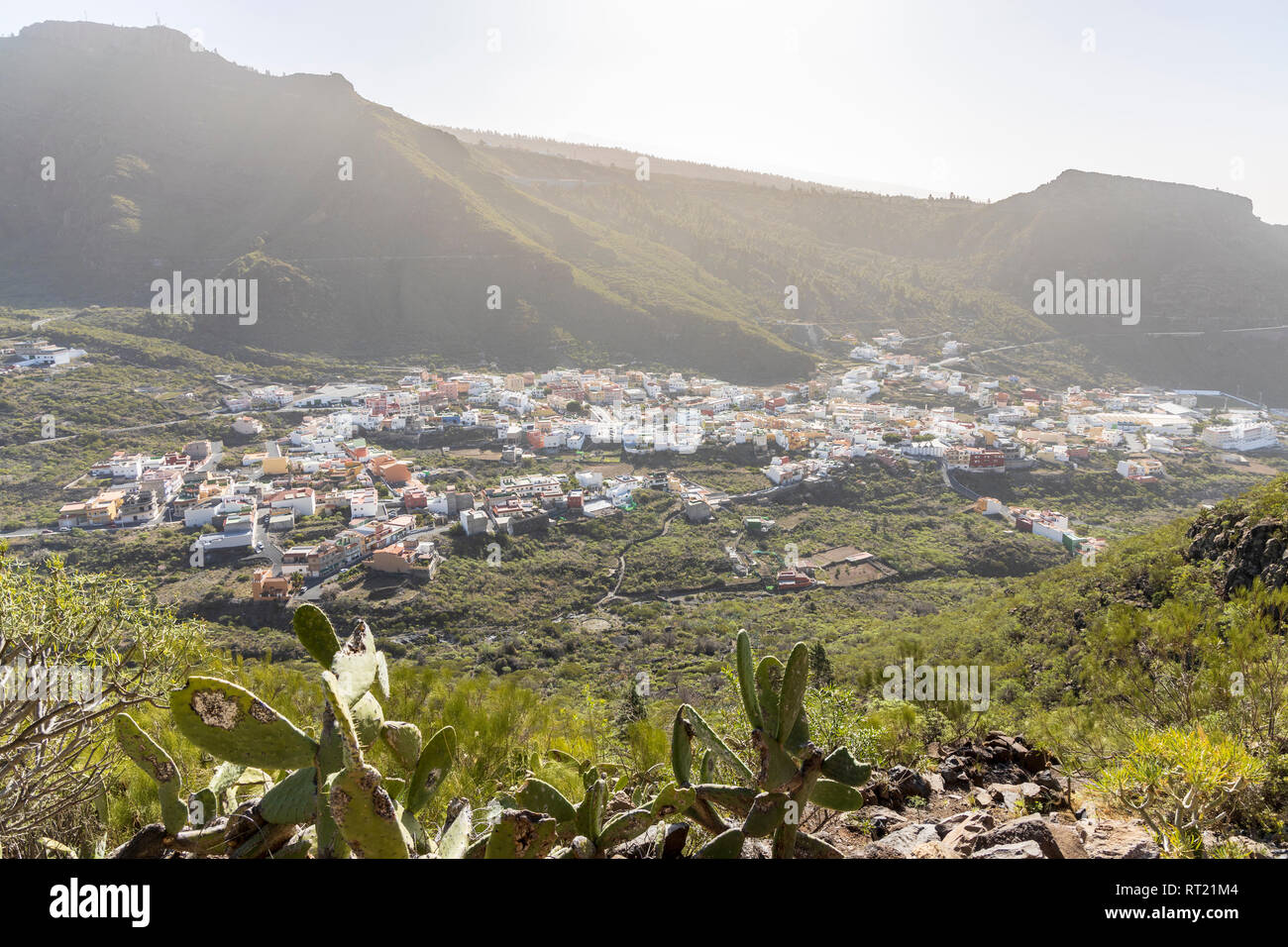 Aerial view over the village of Tamaimo with haze in the air from a calima bringing dust in from the Sahara, Santiago del Teide, Tenerife, Canary Isla - Stock Image