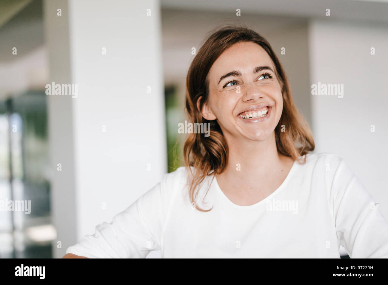 Portrait of a beaming young businesswoman - Stock Image